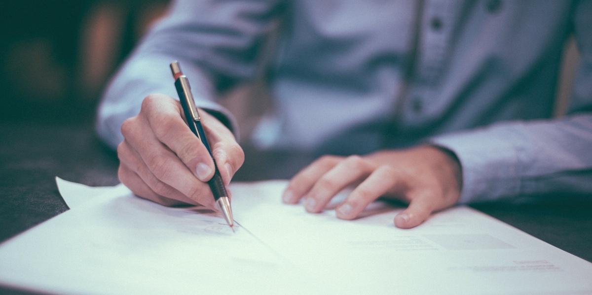 business-man-writing-pen.jpg