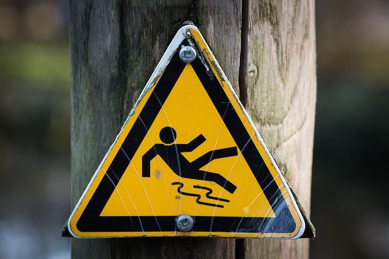 https://www.indinero.com/wp-content/uploads/2016/07/sign-slippery-wet-caution.jpg